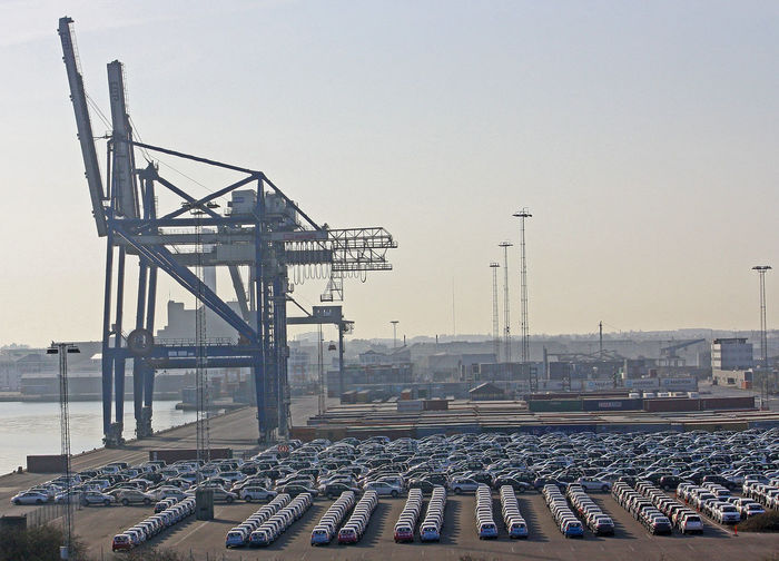 Vehicles in lines ready to be loaded onto container ships - Copenhagen, Denmark A Taste Of Copenhagen Container Crane Copenhagen, Denmark Architecture Built Structure Cars Ready To Be Shipped City Clear Sky Day Industry No People Outdoors Sky Suv's 4x4 New Cars Lost In The Landscape Stories From The City