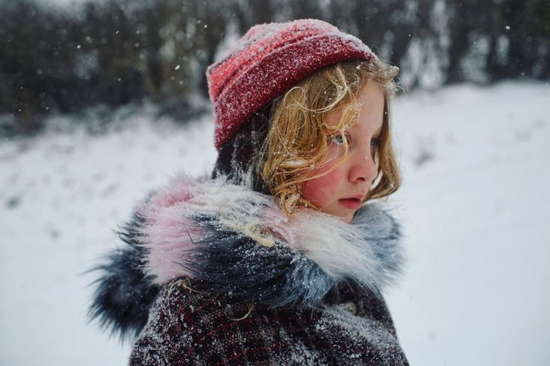 Snow covered Snowing People Adventure Winter Cold Temperature Snow One Person Warm Clothing Headshot Outdoors Childhood Portrait Real People Snowing Child Extreme Weather Hat