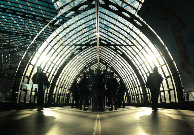 Reflection Arch Architecture Building Built Structure Ceiling Day Group Of People Illuminated Indoors  Lifestyles Men People Public Transportation Railroad Station Real People Rear View Reflection_collection Silhouette Walking Women