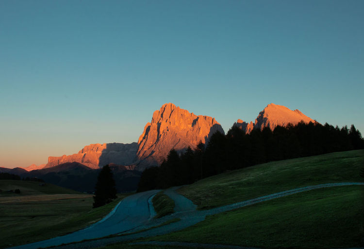 Sunset in Seiser Alm Alpe di Siusi Mountain Dolomites Dolomites South Tyrol Südtirol Sky Environment Scenics - Nature Tranquil Scene Beauty In Nature Tranquility Landscape Copy Space Clear Sky Nature No People Mountain Range Non-urban Scene Land Plant Blue Idyllic Green Color Day Outdoors Mountain Peak