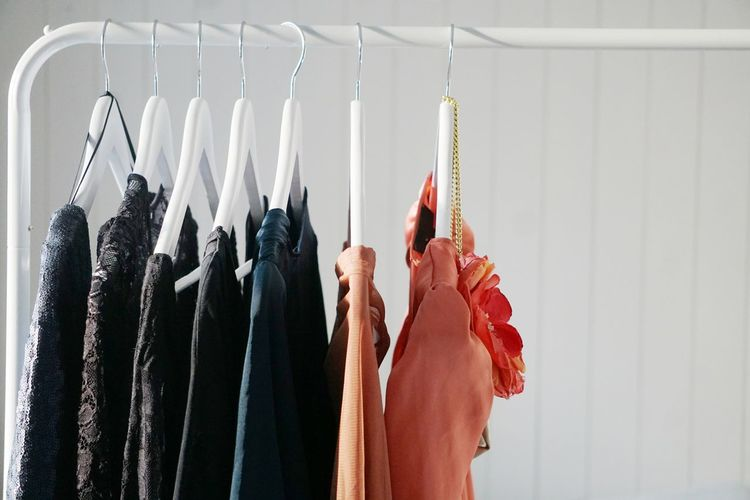 Clothes hanging against wall at home