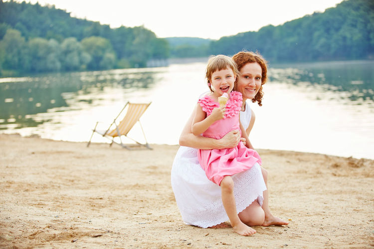 Portrait of mother and daughter eating ice cream