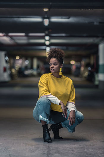 Woman looking away in parking lot