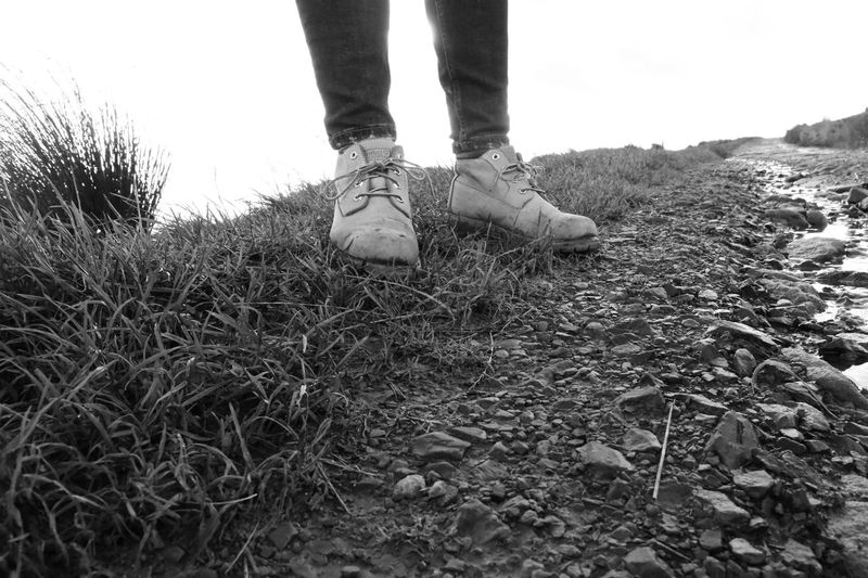 Hiking Adult Black And White Friday Close-up Country Walks Day Field Grass Human Body Part Human Leg Low Section Nature One Person Outdoors People Real People Shoe Shoes Sky Standing Walking Boots