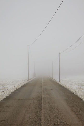 Fog road Shades Of Winter EyeEmNewHere Alone Perspective Road Snow ❄ Winter Day Diminishing Perspective Fog Grey Horizon Over Water Nature No People Outdoors Scenics The Way Forward Go Higher