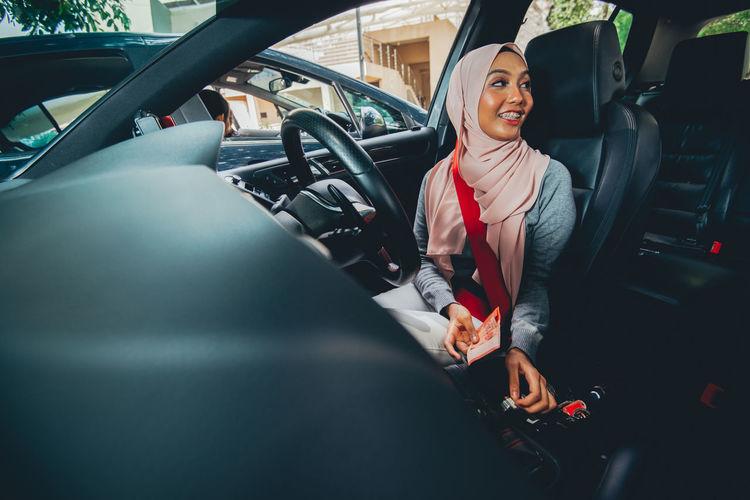 Female driver sitting in car
