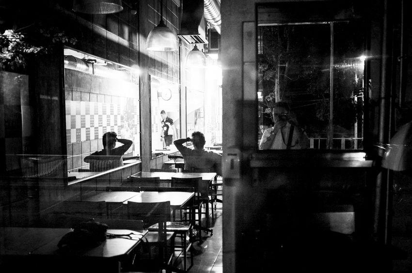 Fujifilm X100. Jan 2016. Limketkai Center,CDO. Glass - Material Indoors  Leisure Activity Lifestyles Men Music Occupation Real People Sitting Technology Window Women