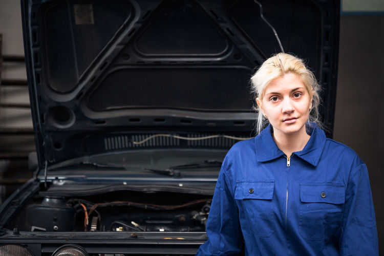 Blue Collar Learning Mechanic Working Workshop Young Apprentice Apprenticeship Auto Mechanic Auto Repair Shop Car Car Mechanic Career Close-up Indoors  Manual Worker Repairing Trainee Women Young Adult