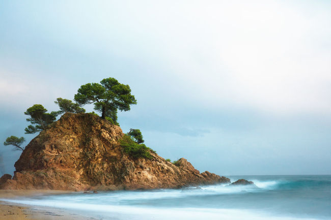Sea Beauty In Nature Water Sky Land Scenics - Nature Beach Tranquility Nature Tranquil Scene Rock No People Rock - Object Day Solid Horizon Over Water Horizon Outdoors Cloud - Sky Stack Rock Trees Copy Space Long Exposure Shot Hill