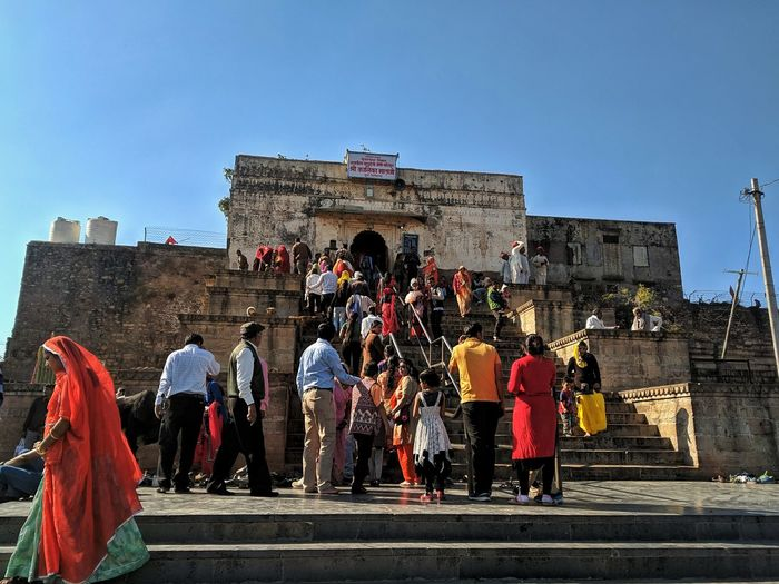 Group of people in front of historical building