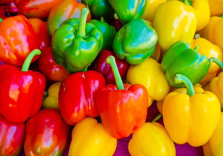 Full frame shot of multi colored bell peppers at market