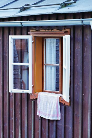 Open window with cloth hanging from sil