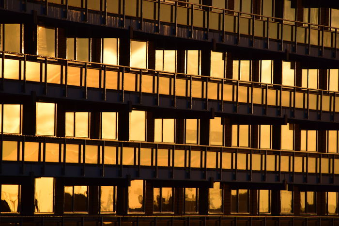 Amber Architecture Backgrounds Building Building Exterior Built Structure City City Life Façade 43 Golden Moments Gold Golden Illuminated Modern No People Office Building Orange Outdoors Reflection Repetition Side By Side Tower Block  Showcase April Cities At Night The Architect - 2016 EyeEm Awards