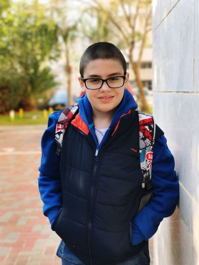 Looking At Camera Portrait Waist Up Child Education Eyeglasses  Focus On Foreground Confidence  Front View One Person Outdoors Children Only Smiling Day Student Childhood People Campus Close-up מייאייפון7 Shotoniphone7plus IPhone7Plus DepthEffects Iphone7plusportraitmode מייגיא
