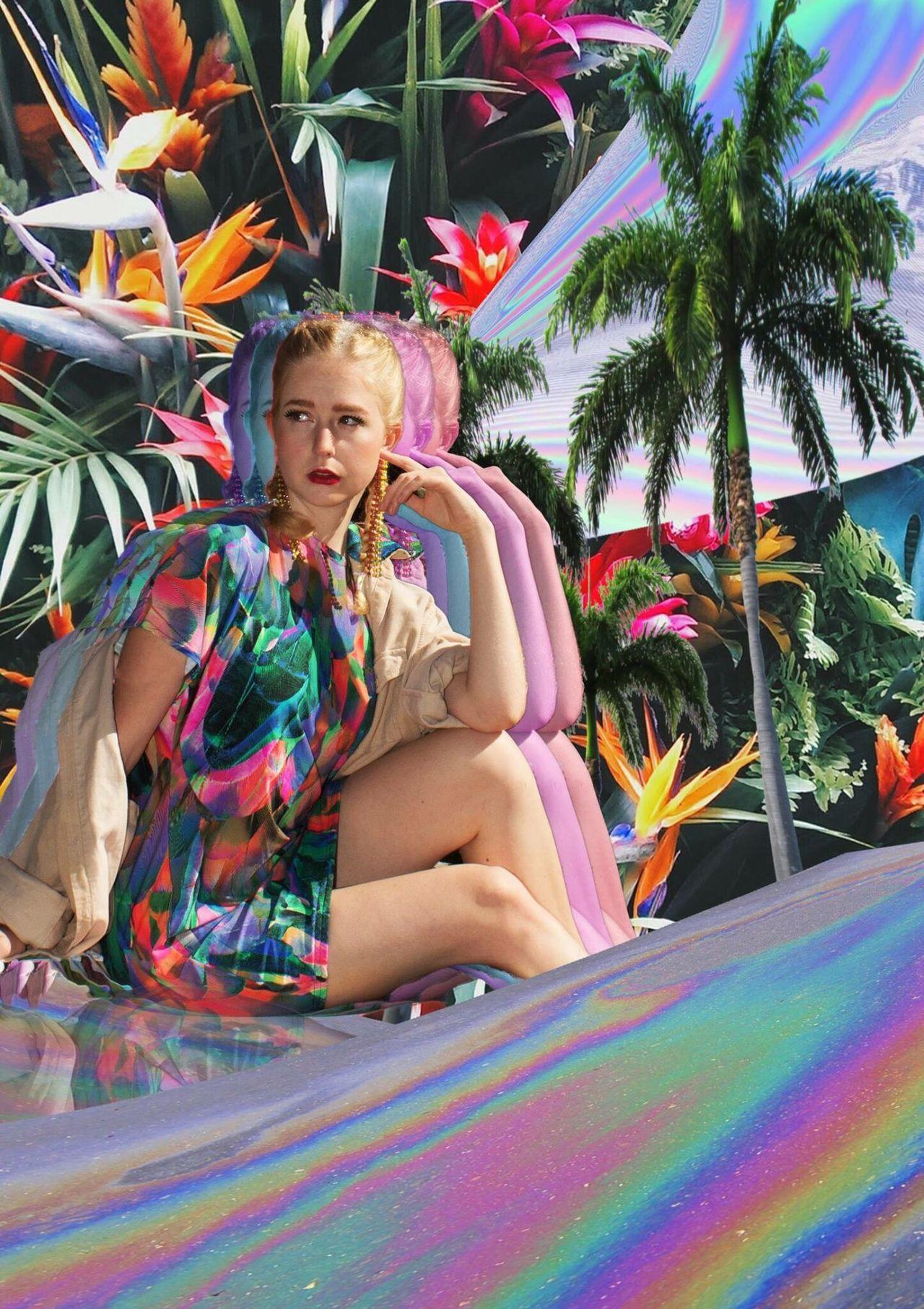 Digital composite image of woman sitting against plants
