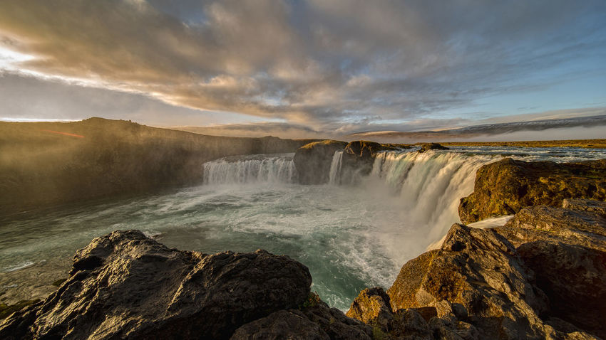 The Goðafoss is a waterfall in Iceland. It is located in the Bárðardalur district of Northeastern Region at the beginning of the Sprengisandur highland road. The water of the river Skjálfandafljót falls from a height of 12 meters over a width of 30 meters. Scenics - Nature Water Beauty In Nature Waterfall Motion Long Exposure Nature Flowing Water No People Outdoors Power In Nature Flowing Goðafoss Waterfall Sunrise Sunset Environment Blurred Motion Majestic Beauty In Nature Horseshoe Falls Rocks Cloud - Sky Sky Rock Rock - Object Solid Sea Non-urban Scene