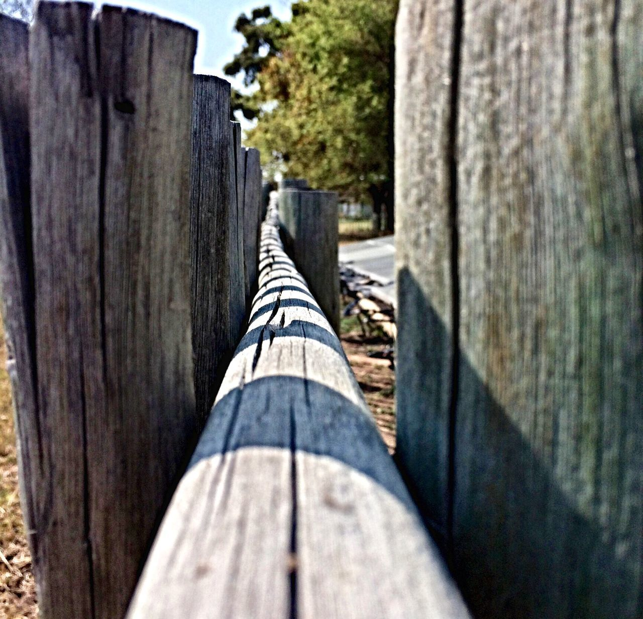 Close-Up Of Sunlight Falling On Wooden Posts