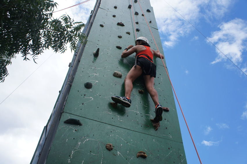 Going up Climbing Flexibility Sport Rock Climbing Extreme Sports Full Length Climbing Wall Climbing Rope Balance Sky Clambering Free Climbing Moving Up Safety Harness Rappelling