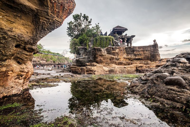 View of tanah lot rock formation against sky