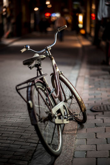 Bicycle parked on footpath by street