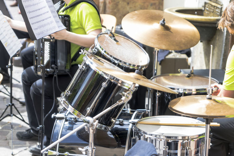 Artist Arts Culture And Entertainment Drum Drum - Percussion Instrument Drum Kit Drummer Drumstick Festival Men Music Musical Equipment Musical Instrument Musician Occupation People Percussion Instrument Performance Playing Real People Rock Music Sitting Skill  Stage