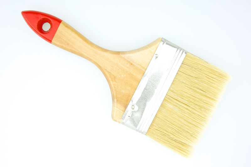 Brown paintbrush has red and brown handle put on white background. Copy Space Decorating Hair Household Housework New Paint Red Work Background Bristles Brown Brush Chrome Clean Close-up Handle Metal Metallic Paintbrush Repair Studio Shot Tool White Wooden