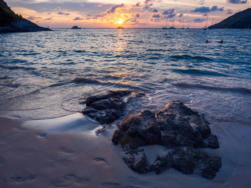 Sunset at Nai Harn beach on Phuket Nai Harn Beach  Phuket Thailand Beach Beauty In Nature Island Nature Outdoors Rock - Object Scenics Sea Sunset Tranquil Scene Tranquility Tropical Water Wave