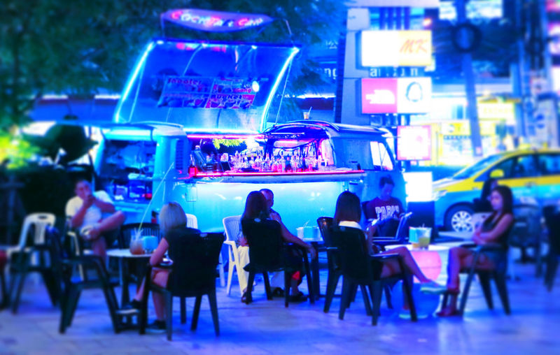 Adult Chair Crowd Fun Places Group Of People Illuminated Large Group Of People Men Night Outdoors People Real People Table Technology Volkswagen Volkswagen Type 2 VOLKSWAGEN TYPE II Women EyeEmNewHere The Street Photographer - 2017 EyeEm Awards