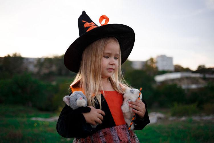 Portrait of girl holding hat