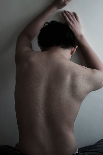 One Person Shirtless Rear View Indoors  Waist Up Human Back Adult Standing Human Body Part Young Adult Men Young Men Real People Lifestyles Skin Hand In Hair Domestic Room Arms Raised Back Nude-Art Sexyboy Conceptual