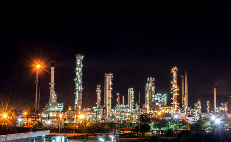 Oil refinery at night Architecture Building Exterior Built Structure Distillation Factory Fuel And Power Generation Gasoline Illuminated Industry Night No People Oil Industry Oil Refinery Petrochemical Plant Refinery Sky Smoke Stack
