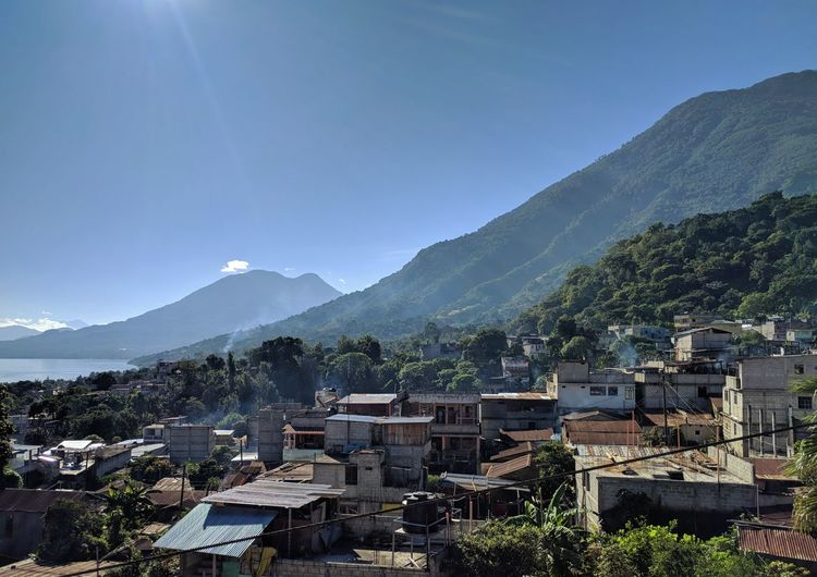 San Pedro La Laguna Mountain Nature No People Landscape Mountain Range Outdoors Tree Day Architecture Scenics Beauty In Nature Sky Green Color Tranquil Scene Central America Guatemala Lake View Village Tranquility Traveling Nature Water Sun Blue