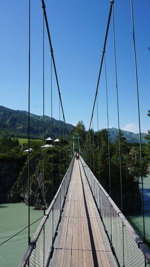 Footbridge against clear sky