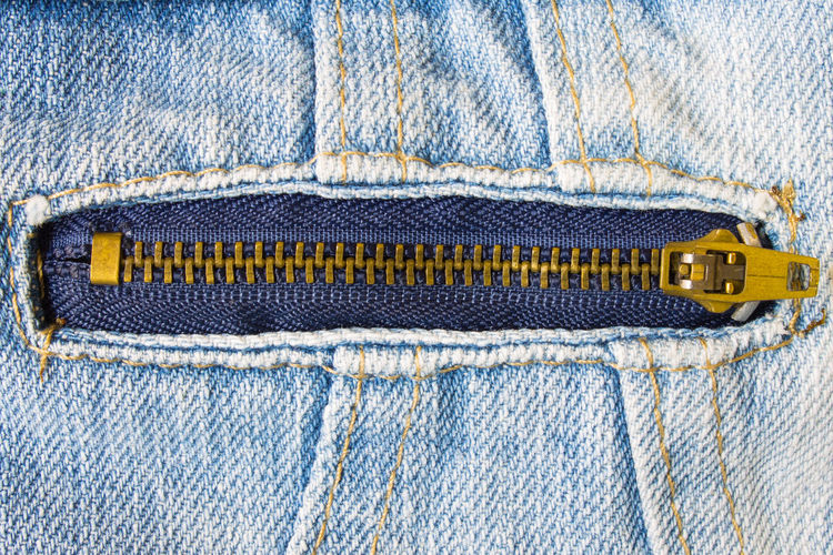 Brass Zip on Jeans Jacket Button Zipper Blue Buttons Casual Clothing Close-up Clothing Cotton Denim Denim Fashion Denim Jacket Fashion Garment Indoors  Jeans Material No People Personal Accessory Pocket  Single Object Studio Shot Textile Textile Industry Textured  Zip