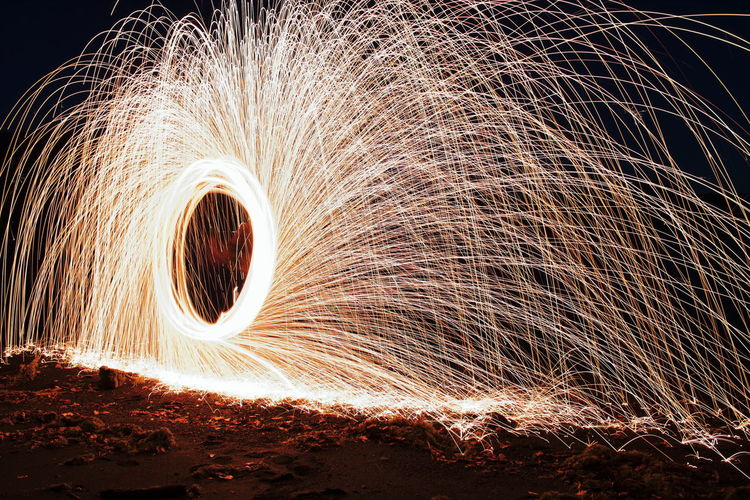 Steel Wool Steel Wool Art Passion Beautiful Action Power Man Fire Sparks Circle Test Fun Long Time Night Nightphotography Evening Heat EyeEm Selects EyeEm Gallery Photography Composition Close-up Light Painting Light Trail Lit Flame
