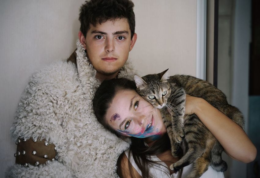 Family portrait. Woman Two People Couple - Relationship Couple Friendship Pets Portrait Looking At Camera Men Bonding Headshot Pet Owner Cat Feline Pampered Pets At Home