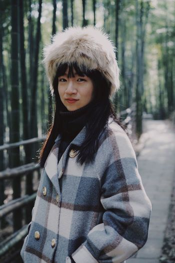 Bamboo - Plant One Person Real People Leisure Activity Lifestyles Clothing Looking At Camera Young Women Portrait Front View Tree Focus On Foreground Standing Warm Clothing