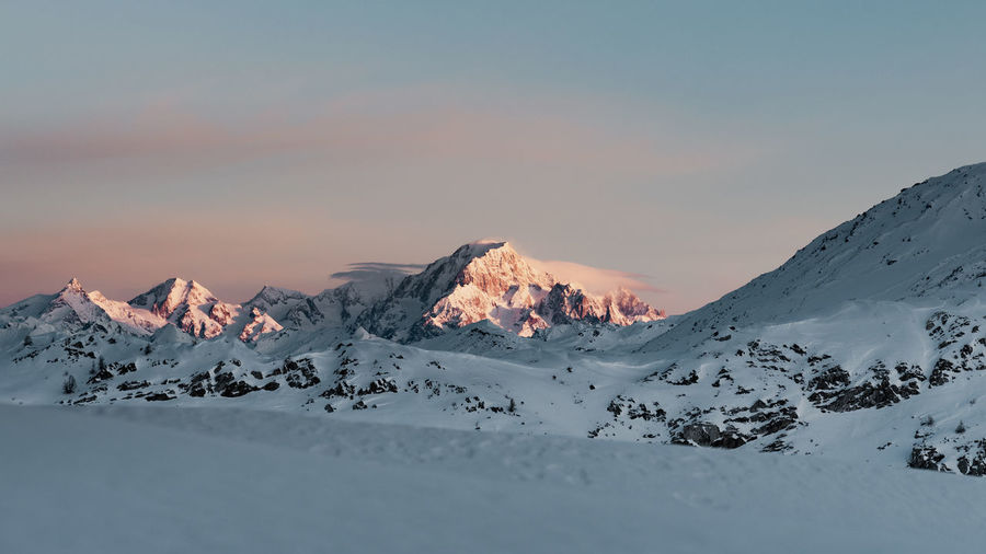 Scenic view of snowcapped mont blanc against sky during sunrise