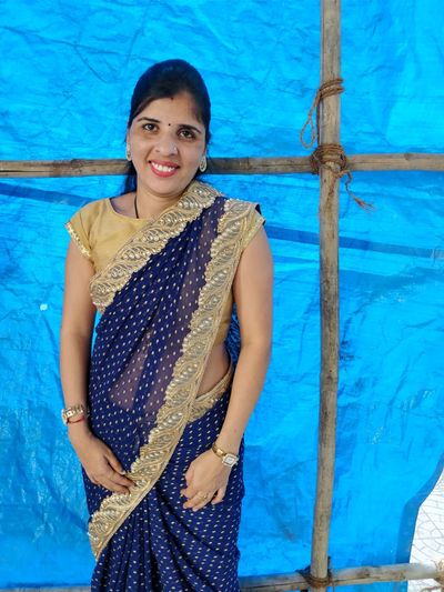 Adult Bangle Beautiful Woman Blue Day Front View Happiness Lifestyles Looking At Camera One Person One Woman Only One Young Woman Only Only Women Outdoors Portrait Posing Real People Sari Smiling Standing Three Quarter Length Traditional Clothing Waist Up Young Adult Young Women