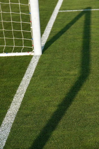 White line Sport Grass Green Color Shadow Nature Soccer Soccer Field Sunlight Playing Field No People Team Sport Outdoors Net - Sports Equipment Absence Competition Single Line Yard Line - Sport Turf White Color Goal Post White Line