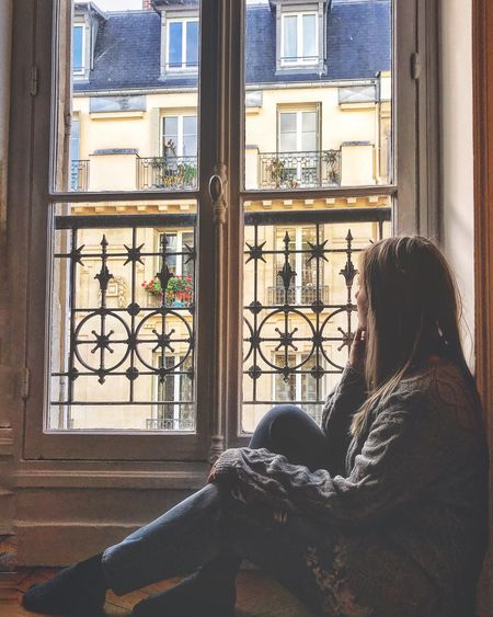 Dreaming Window One Person Lifestyles Real People Sitting Window Sill Leisure Activity House Architecture Balcony Building Exterior Day Side View Built Structure Women Relaxation Looking Through Window Young Adult Young Women Indoors  Love Yourself