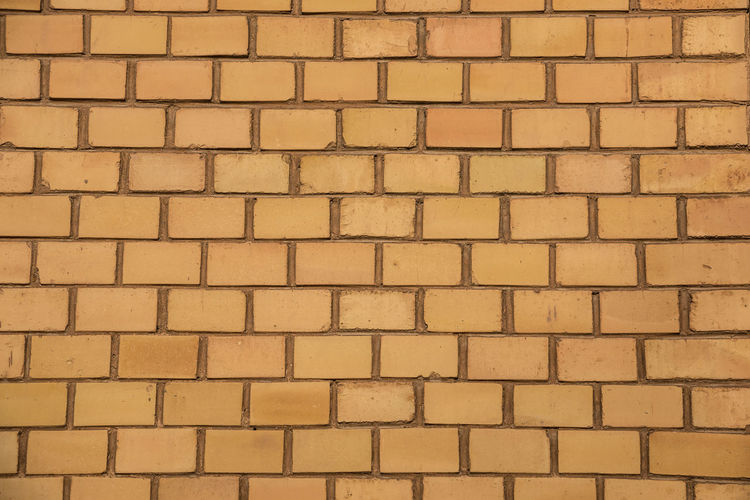 Old empty brick house factory wall with yellow bricks Full Frame Backgrounds Pattern No People Wall Textured  Architecture Built Structure Brick Repetition Wall - Building Feature Arrangement Side By Side Brick Wall Day Large Group Of Objects Outdoors Close-up Yellow Tile