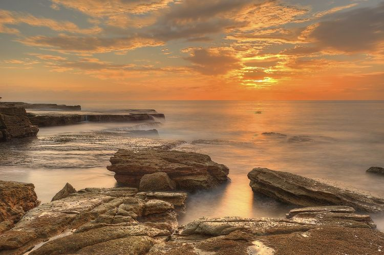 The rocks near Maroubra Beach, Sydney, Australia. Beach Beauty In Nature Cloud - Sky Horizon Horizon Over Water Land Maroubra Motion Nature No People Orange Color Outdoors Rock Rock - Object Scenics - Nature Sea Sky Solid Sunset Sydney Tranquil Scene Tranquility Water