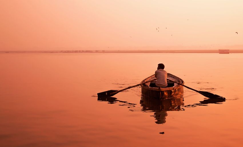 Morning on Ganga river @ #Boattrip #Infinite #ganga #travel #varanasi Beauty In Nature Clear Sky Fisherman Men Nature Orange Color Outdoors Reflection Scenics Silhouette Tranquility Water