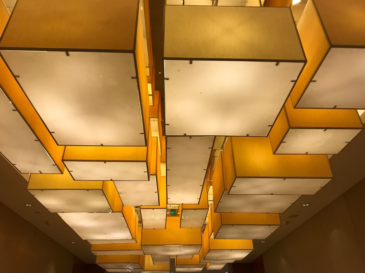 yellow, low angle view, ceiling, architecture, no people, built structure, backgrounds, indoors, modern, illuminated, sky, day