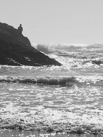 Old Man And The Sea EyeEm Selects Waves Fisherman Tide Coming In I Love Black And White Quiet Day On The Beach I Love The Ocean The Week On EyeEm