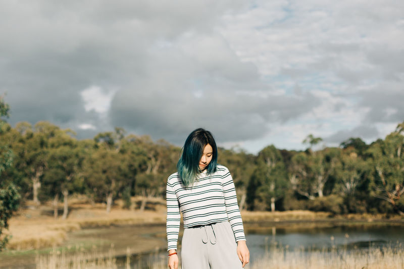 Real People One Person Cloud - Sky Standing Sky Lifestyles Young Adult Leisure Activity Front View Land Nature Young Women Casual Clothing Focus On Foreground Women Day Adult Non-urban Scene Outdoors Beautiful Woman Hairstyle People Portrait Travel The Traveler - 2019 EyeEm Awards