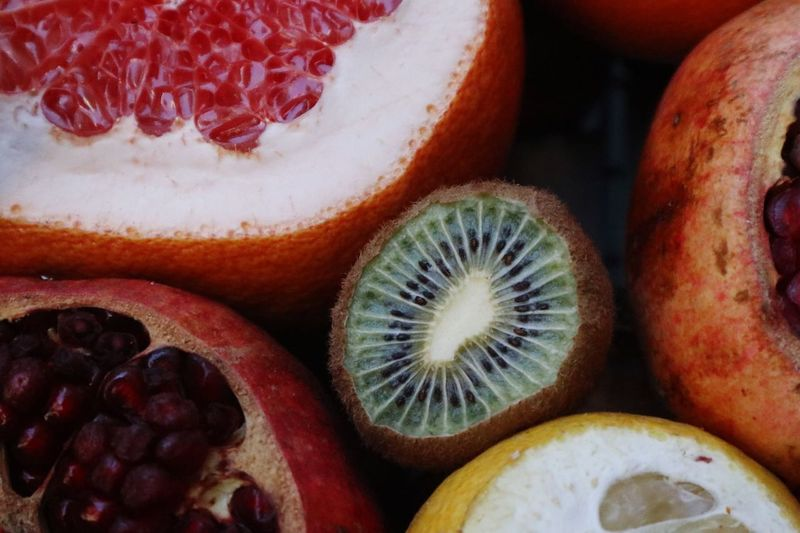 Food And Drink Food Healthy Eating Wellbeing Fruit Freshness Close-up No People Seed Cross Section Halved High Angle View Still Life Indoors  Pomegranate SLICE Kiwi Red Healthy Lifestyle Juicy