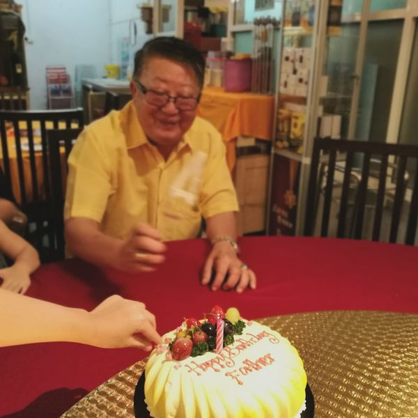 Cut your hand....happy birthday father.. Sitting Person Casual Clothing Indoors  Young Adult Lifestyles Leisure Activity Relaxation Front View Full Length Red Domestic Life Mature Adult Focus On Foreground P9 Huawei People And Places Showcase October
