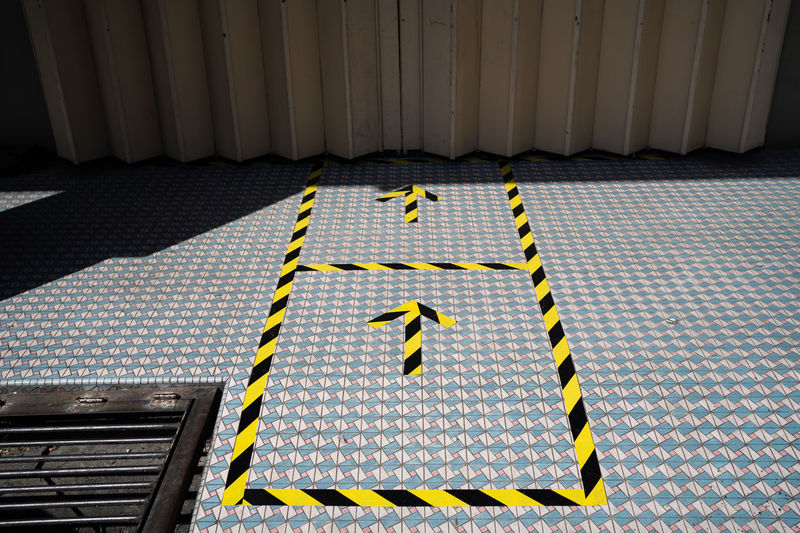 High angle view of yellow marking on footpath